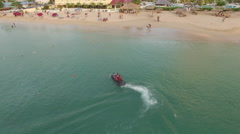 Speed boat and tourists at the beach Stock Footage