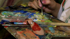 Mixing of the paint on the palette Stock Footage