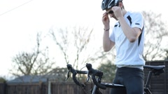 A Young Athletic Man Sets Off On A Bicycle Ride Stock Footage