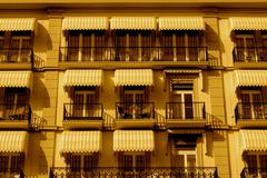 1950's hotel with awnings over hotel room windows - stock photo