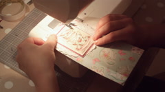Hands of a woman crafting and scrap-booking christmas cards Stock Footage