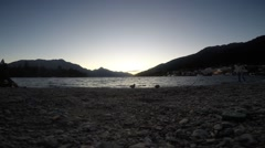 Time-lapse of sunset at Queenstown New Zealand lake and mountains beach - stock footage