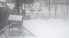 Back yard playground during a snow storm through a foggy bedroom window - stock footage