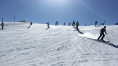 Skiers going down a slope on a sunny day Park City Utah USA Stock Footage