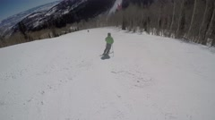 GoPro Man skiing down mountain with POV of man following skier UGC Park City Stock Footage