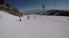 GoPro Skiing down a mountain with chairlift above and other skiers POV UGC Park Stock Footage