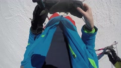 GoPro skier putting on gloves and poles to ski POV UGC Park City Utah USA Stock Footage