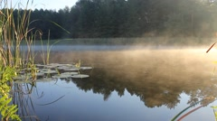 Morning fog floats on the surface of the lake Stock Footage
