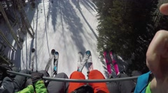 GoPro View of skiers laps going up a chair lift sunny day Park City Utah USA Stock Footage