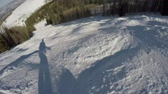 GoPro skier's shadow going down moguls POV UGC Park City Utah USA Stock Footage