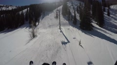 GoPro chairlift skiers sunny day Park City Utah USA Stock Footage