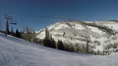 GoPro view of chairlift going up mountain from ski hill Park City Utah USA Stock Footage
