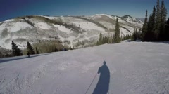 GoPro shadow skiing down mountain sunny day POV UGC Park City Utah Stock Footage