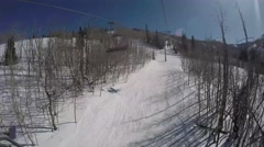 GoPro view from chairlift going up mountain Park City Utah USA Stock Footage