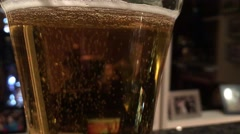 Light Beer carbination in a glass at an dinner party in New York City NYC Stock Footage