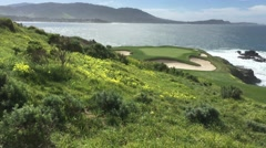 Pebble beach hole 7 with flowers pacific ocean sunny day golf course - stock footage
