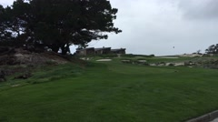 Spyglass hole 5 windy cloudy day from tee box golf course - stock footage
