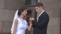 The groom kisses the bride's hand - stock footage