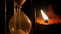 Hourglass and clay oil lamp - stock footage