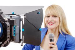 Portrait of elegant blonde woman TV reporter Stock Photos