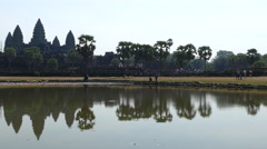 Angkor Wat with reflection in the lake on a bright sunny day Stock Footage