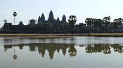 Mass tourism time lapse from Angkor Wat with reflection in the lake Stock Footage