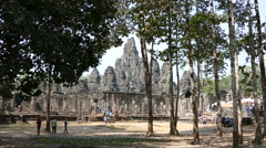 Tourists around the Bayon Khmer temple at Angkor Wat Cambodia Stock Footage