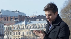 Handsome man using tablet outside - stock footage