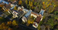 Old castle in a city park - a sunny autumn day, bright crowns of trees Stock Footage