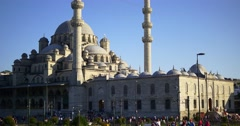 Crowds strolling around Yeni Cami at the city center in Istanbul, Turkey.  Stock Footage