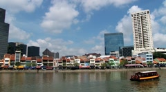 Iew to the historical quay buildings at the river bank in Singapore, Singapore. Stock Footage