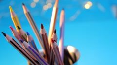 Stock Video Footage of Coloured Crayons - blue background 03