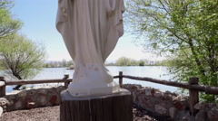 Mother Mary statue on the pond side Stock Footage