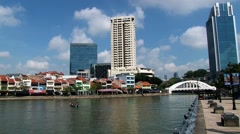 View to the modern and historical quay buildings at the river bank in Singapore. Stock Footage