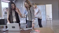 Businesswomen working in office Stock Footage