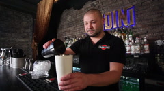 Bartender making a cocktail Stock Footage