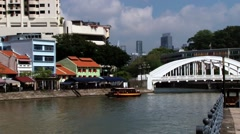 People enjoy boat cruise by the historical part if the city in Singapore. Stock Footage