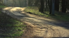 Village road in morning light. - stock footage