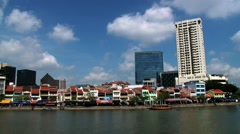 View to the historical quay buildings at the river bank in Singapore, Singapore. Stock Footage