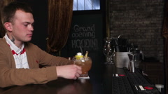 a man drinking a cocktail at a bar HOUDINI Stock Footage