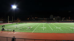 Football field and track at night (Time lapse) - stock footage