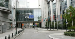 Panning from  European Parliament building in Brussels, Belgium to taxi car Stock Footage