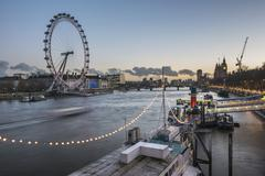 Tattershall Castle (River Thames Boat Restaurant) and The London Eye at night - stock photo