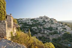 Hilltop village of Gordes with castle and church at sunrise, Provence, - stock photo