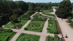 Quadrocopter shoot beautiful green summer garden with flowerbeds and fountains - stock footage