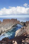 Rock arch, Arco de la Tosca at Punta de la Dehesa, lava coast, UNESCO biosphere Stock Photos