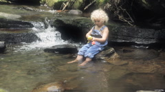 Little Boy In Over Alls Going Fishing In Creek Stock Footage