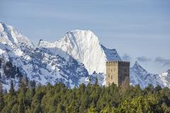 The Belvedere Tower frames the snowy peaks and Peak Badile on a spring day, Stock Photos