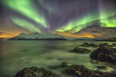 Stock Photo of Northern Lights on the icy sea of Svensby, Lyngen Alps, Troms, Lapland, Norway,