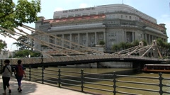 View to the Cavenagh bridge and historical Fullerton hotel in Singapore. Stock Footage